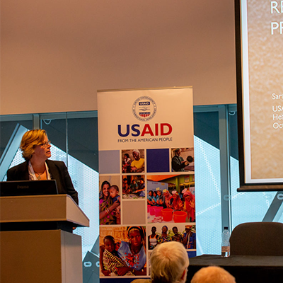 USAID's employee giving a presentation on the role of implementation research in accelerating uptake of essential services and approaches to improve maternal, newborn and child health