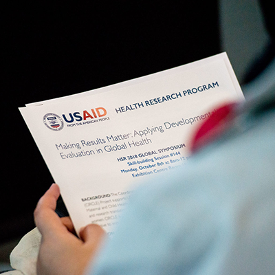 USAID's employee reading an USAID factsheet